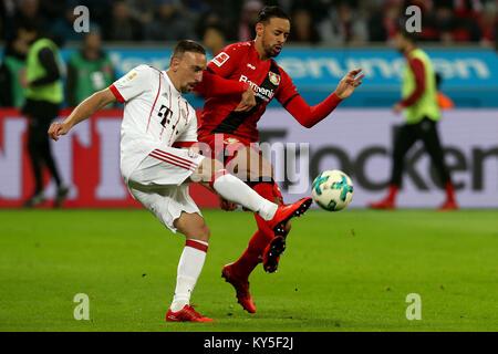 Leverkusen, Germany. 12th Jan, 2018. Franck Ribery (L) of Bayern Munich vies with Karim Bellarabi of Leverkusen - Stock Photo