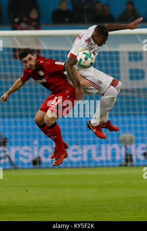 Leverkusen, Germany. 12th Jan, 2018. Jerome Boateng (R) of Bayern Munich vies with Kevin Volland of Leverkusen during - Stock Photo