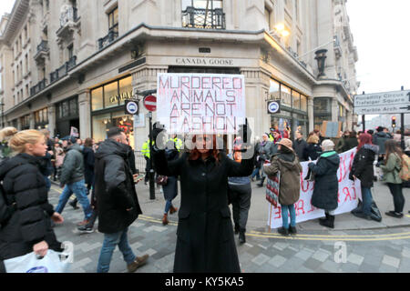London, UK. 13th Jan, 2018. Anti fur protesters gathered outside Canada Goose shop in Oxford Street today, to make - Stock Photo