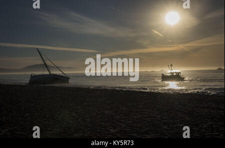 Santa Barbara, California, USA. 13th Jan, 2018. A vessel assist boat performs a recovery operation on a sailboat - Stock Photo