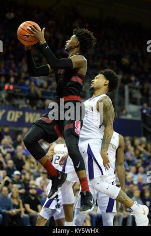 Seattle, WA, USA. 13th Jan, 2018. Stanford's freshman point guard Daejon Davis (1) gets off a shot getting by UW - Stock Photo