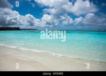 TADINE,MARE,NEW CALEDONIA-DECEMBER 3,2016: Tourists swimming in the Pacific Ocean waters on excursion at Yejele - Stock Photo