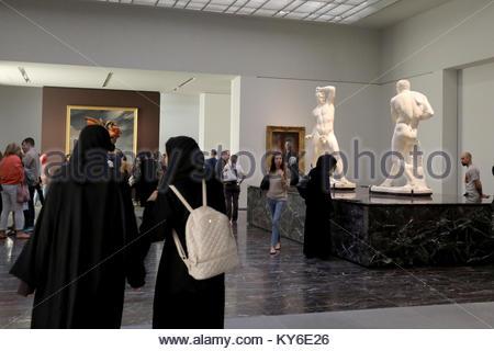 Abu Dhabi, United Arab Emirates. 12th Jan, 2018. Local women walking through the Louvre Abu Dhabi in the UAE capital - Stock Photo