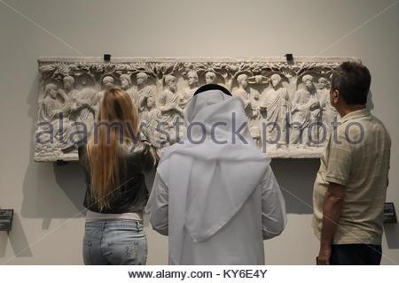 Abu Dhabi, United Arab Emirates. 12th Jan, 2018. Visitors examine the displays in the Louvre Abu Dhabi in the UAE - Stock Photo