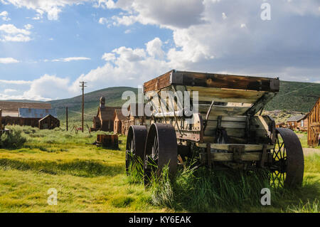 An old wooden wagon with rusty iron wheels in the the American Ghost town of Bodie. - Stock Photo