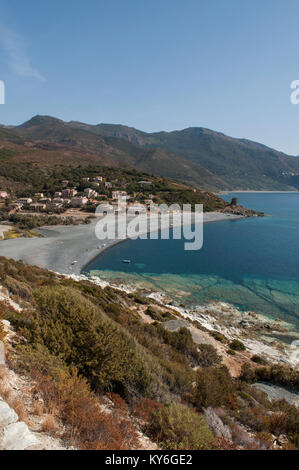 Corsica: the coast of the western side of the Cap Corse, famous for its wild landscape, with view of one of the - Stock Photo
