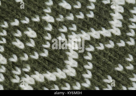 Macro color image of green and white knitted texture. - Stock Photo