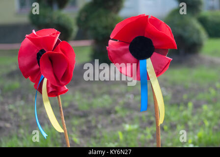 Red poppies as a symbol of the Victory over Nazism and commemoration of the victims of World War II, celebrated - Stock Photo