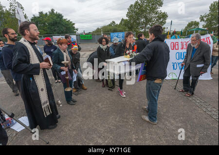 The coffin is laid down on the pavement beside the approch road to the ExCeL centre and the mock funeral by London - Stock Photo