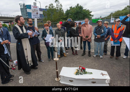 The mock funeral by London Catholic Workers for victims of the arms trade begins next to the road leading to the - Stock Photo