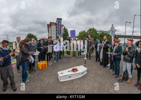 The mock funeral by London Catholic Workers for victims of the arms trade next to the road leading to the ExCeL - Stock Photo