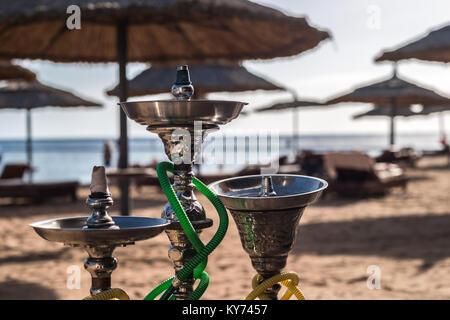 Three luxury shisha hookahs on the sandy beach of Red Sea in Sharm El Sheikh, Egypt. Close-up - Stock Photo