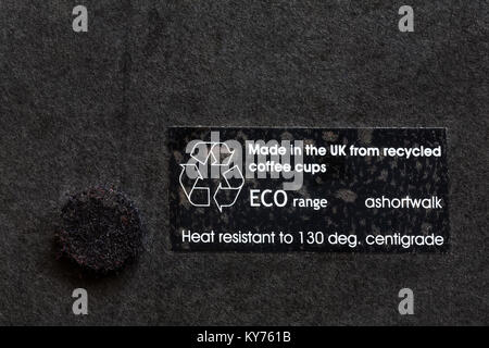 label on back of black place mat coaster - made in the UK from recycled coffee cups ECO range - Stock Photo