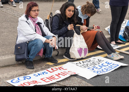 Faith groups had blocked the road before Pax Christi led 'Prayers of Repentance' outside the ExCeL centre where - Stock Photo