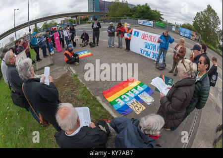 The Pax Christi led 'Prayers of Repentance' outside the ExCeL centre where the DSEi Arms Fair begins shortly. - Stock Photo