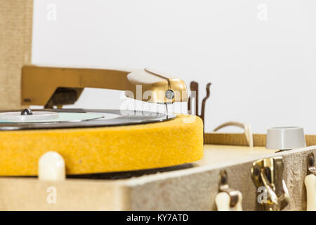 Macro close up of vintage record player needle on 45 rpm disk. - Stock Photo