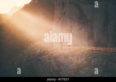 Woman Traveler with backpack hiking on cliff Travel Lifestyle concept adventure active vacations outdoor rocky mountains - Stock Photo