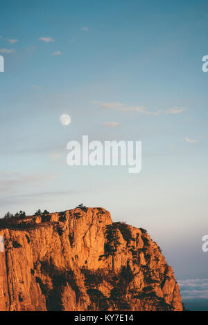 Rocky Mountains cliff and moon sunset Landscape Travel aerial view serene scenery wild nature - Stock Photo