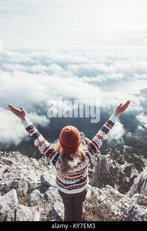 Happy woman traveler on mountain summit hands raised up Travel Lifestyle success concept adventure active vacations - Stock Photo