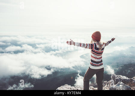 Happy woman traveler on mountain summit hands raised Travel Lifestyle success concept adventure active vacations - Stock Photo