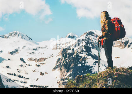 Traveler hiking at mountains Travel Lifestyle concept adventure summer vacations outdoor enjoying beautiful landscape - Stock Photo