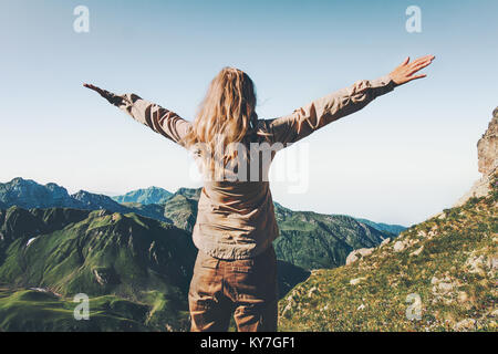 Happy Woman traveler over mountains raised hands Travel Lifestyle success and adventure concept summer vacations - Stock Photo