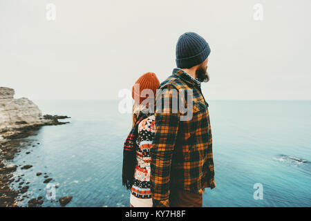 Couple lovers Man and Woman standing backs together Love and Travel happy emotions Lifestyle concept. Young family - Stock Photo