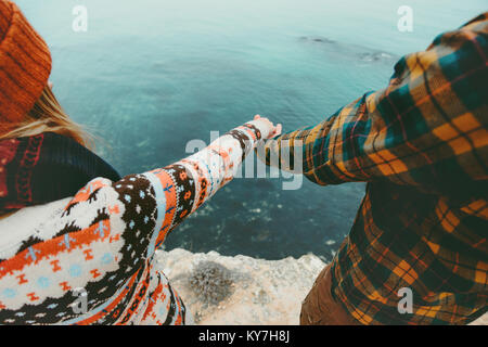 Couple in love holding hands Man and Woman Travel Lifestyle concept. Young family traveling romantic vacations autumn - Stock Photo