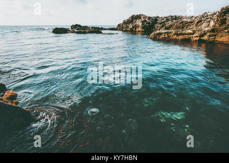 Blue Sea and rocky seaside Landscape calm idyllic scenic view vacations travel - Stock Photo