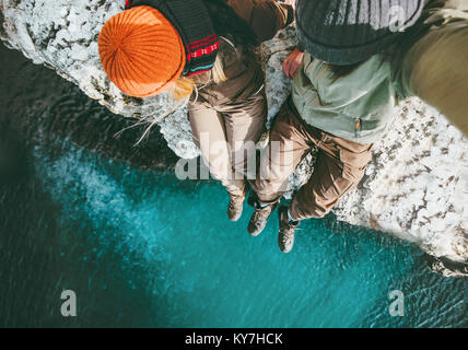 Couple in love Man and Woman sitting together above sea on cliff Travel happy emotions Lifestyle concept. Young - Stock Photo