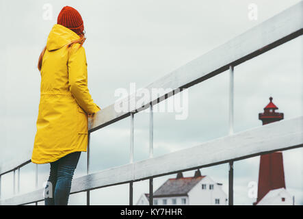 Woman traveler sightseeing lighthouse landscape in Norway Travel Lifestyle concept adventure vacations outdoor - Stock Photo