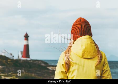 Traveler Woman enjoying Norway lighthouse sea landscape Travel Lifestyle solitude concept scandinavian vacations - Stock Photo
