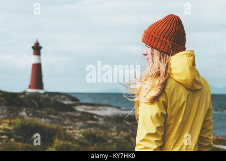 Woman sightseeing lighthouse sea landscape in Norway Travel Lifestyle concept scandinavian vacations outdoor. Blonde - Stock Photo