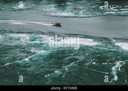 Saltstraumen sea whirlpools and boat in Norway Travel Lifestyle aerial view - Stock Photo