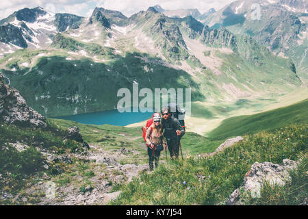 Couple travelers Man and Woman climbing in mountains Love and Travel happy emotions Lifestyle concept. Young family - Stock Photo