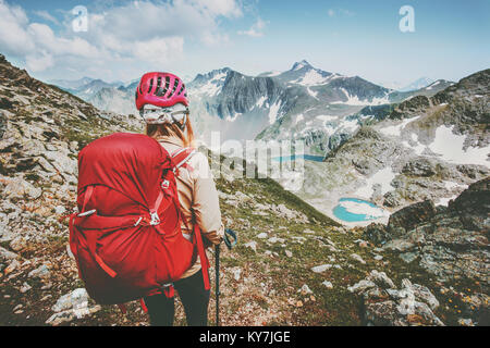 Adventurer tourist hiking in mountains with backpack Travel Lifestyle hiking adventure concept summer vacations - Stock Photo
