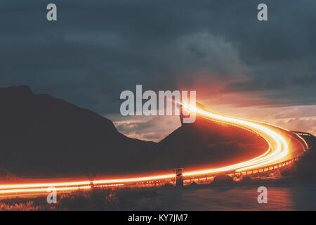 Atlantic road in Norway night Storseisundet bridge over ocean way to sky scandinavian travel landmarks - Stock Photo