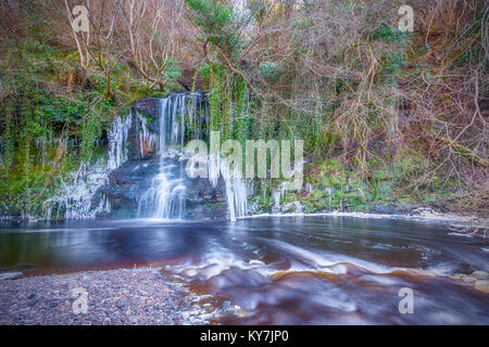 This waterfall sits in a gorge in Calderwood Country Park, between East and Mid Calder, West Lothian.The river in - Stock Photo