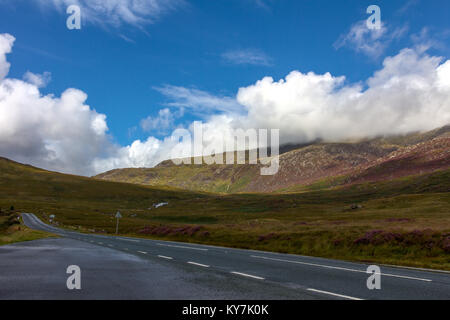 A bracketed landscape photograph taken in Snowdonia National Park looking East from a layby on the A4086 towards - Stock Photo
