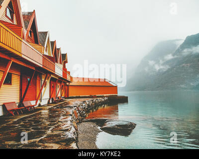 Cozy wooden country houses terrace exterior mountains and fjord view in Norway scandinavian style - Stock Photo