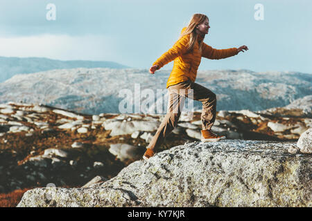 Happy Woman running outdoor in mountains Travel healthy Lifestyle concept adventure positive emotions and motivation - Stock Photo