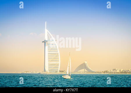Dubai, UAE, March 31, 2017: seaside view of world's famous Burj Al Arab and Jumeirah Beach hotels - Stock Photo