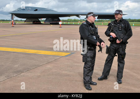 Northrop Grumman B-2 Spirit stealth bomber with armed police guard at RAF Fairford International Air Tattoo airshow. - Stock Photo