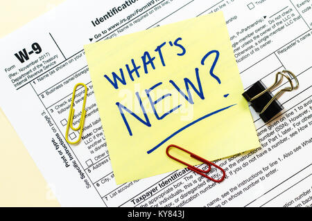 A W9 Tax Form With Tax Time Written On A Sticky Note Stock Photo