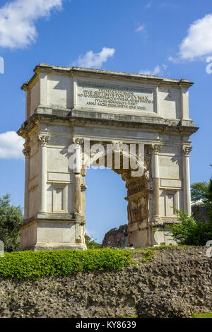 The Arch of Titus is a 1st-century honorific arch, located on the Via Sacra, Rome, Italy, just to the south-east - Stock Photo