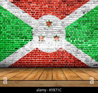 Burundi flag painted on brick wall with wooden floor - Stock Photo