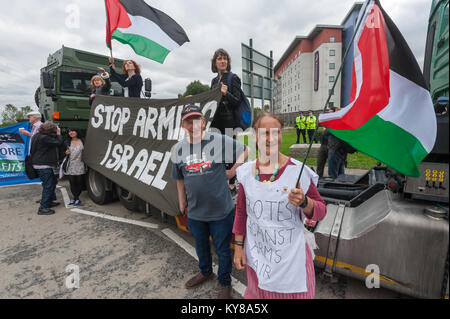 Protesters with banners and flags at the lorry they have stopped for 'Stop Arming Israel', the first day of a week - Stock Photo