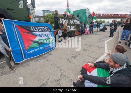 Protesters alongside the lorry they have stoppe at 'Stop Arming Israel', the first day of a week of action against - Stock Photo