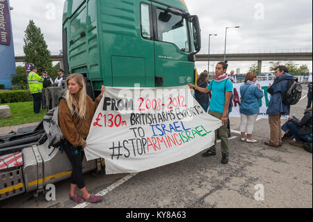 A banner states that from 2008-12 Britian exported £130m of arms to Israel. at 'Stop Arming Israel' was the first - Stock Photo