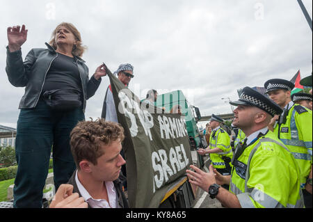 Police warn protesters who have stopped a lorry at 'Stop Arming Israel', the first day of a week of action against - Stock Photo